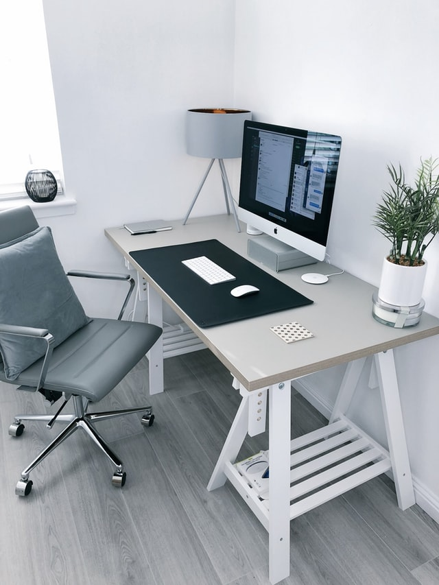 work desk, chair, computer, plant and lamp - the ingredients of an effective home workspace.